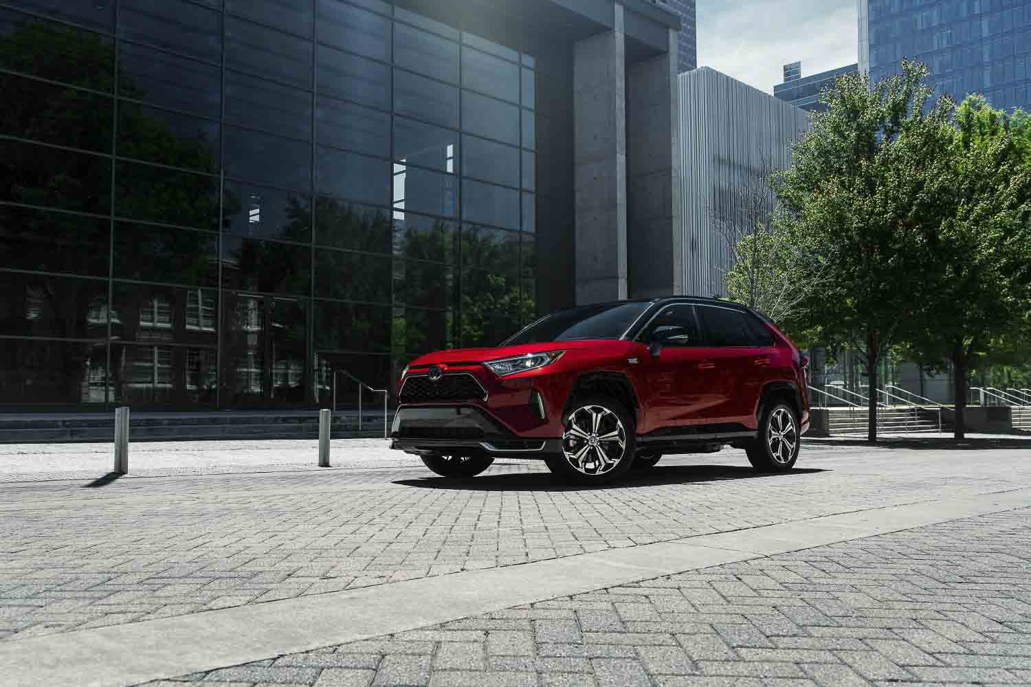 three quarter front view of the 2021 Toyota RAV4 parked in the city