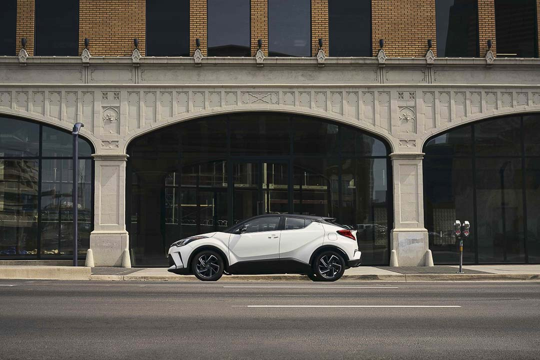 side view of the 2021 Toyota C-HR parked on a road