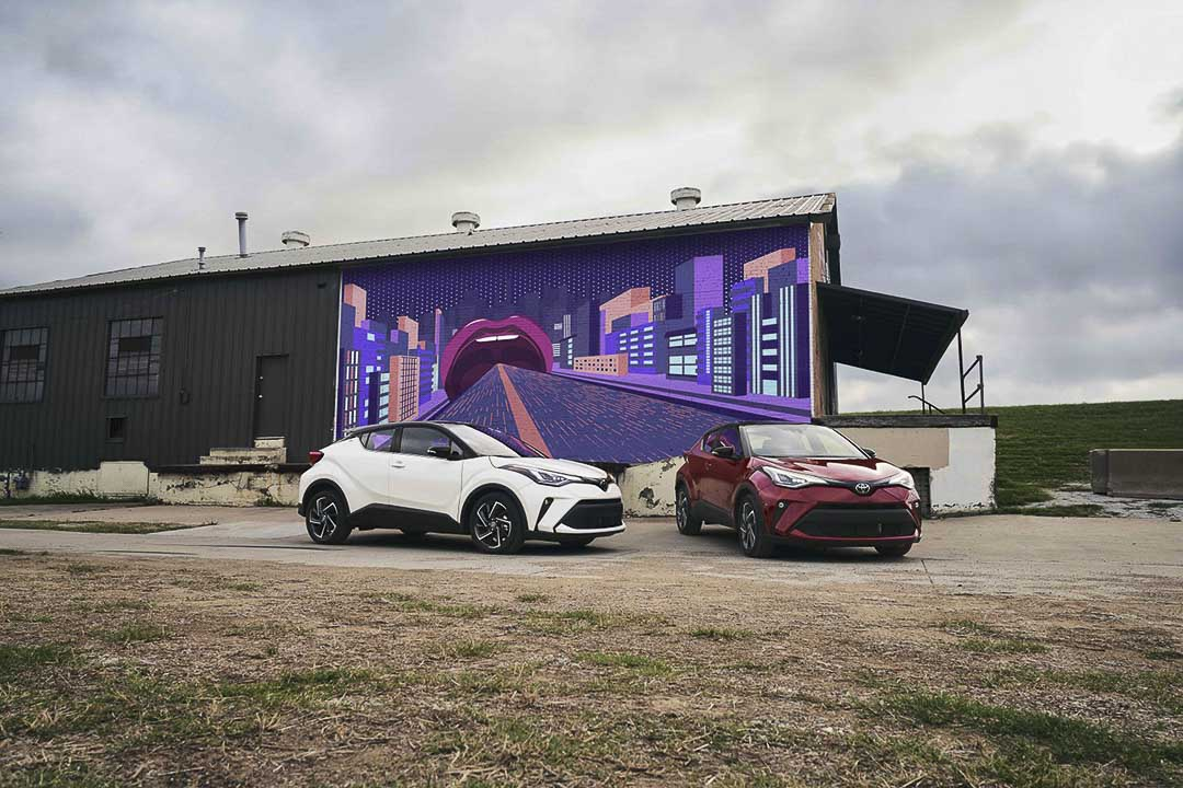 view of two 2021 Toyota C-HR parked close to a building