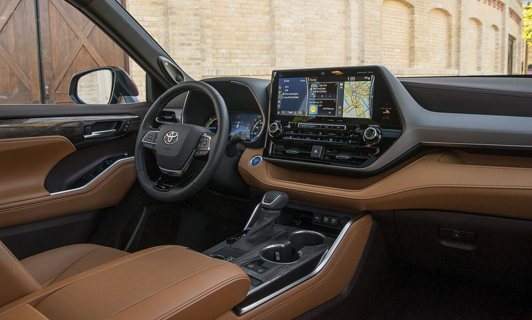 view inside of the 2021 Toyota Highlander with the steering wheel and central console