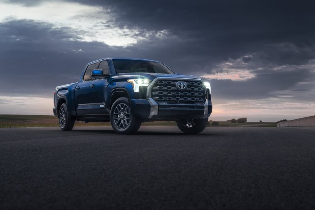 Front 3/4 view of 2022 Toyota Tundra parked outside under dark cloudy sky