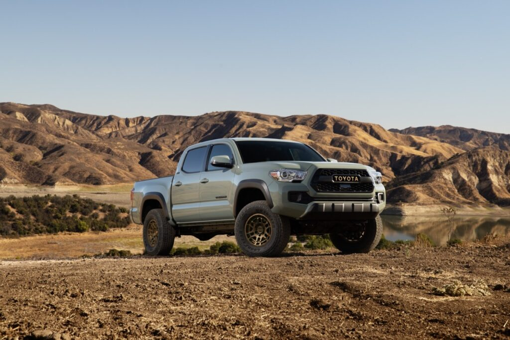 Front 3/4 view of the 2022 Toyota Tacoma Trail parked with its back to the mountains